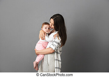 Portrait of a loving young mother holding her little baby