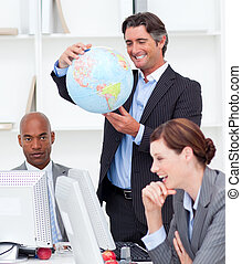 Portrait of a lucky business team talking about globalization
