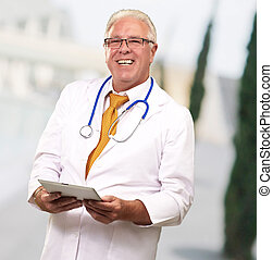 Portrait Of A Male Doctor Holding A Tab, Background
