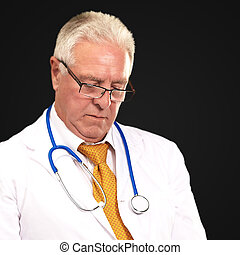 Portrait Of A Male Doctor Holding A Tab On A Black Background