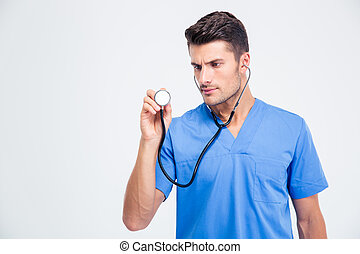 Portrait of a male doctor holding stethoscope
