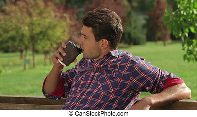 Portrait of a male drinking coffee outdoors