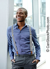 male fashion model with suspenders smiling