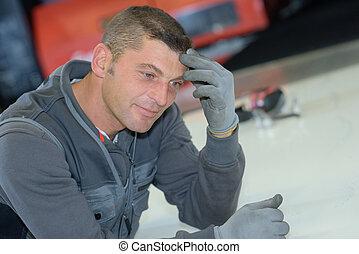 portrait of a male mechanic smiling
