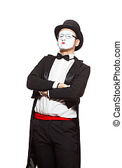 Portrait of a male mime artist performing, isolated on white background. Symbol of superiority, arrogance, pride