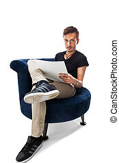 Portrait of a male sitting on chair