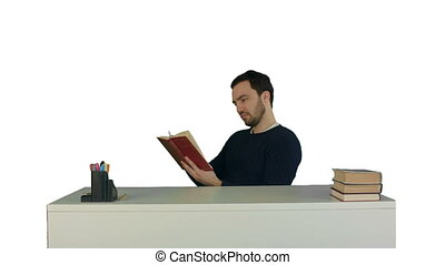 Portrait of a male student reading a book on white background isolated