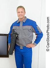 Technician Holding Amplifier