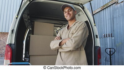 Portrait of a male van driver outside a warehouse