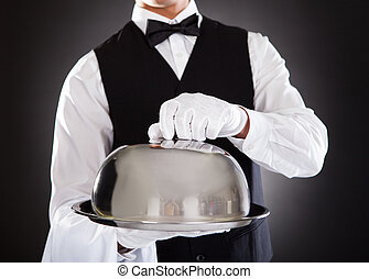 Male Waiter Holding Tray And Lid - Portrait Of A Male Waiter...