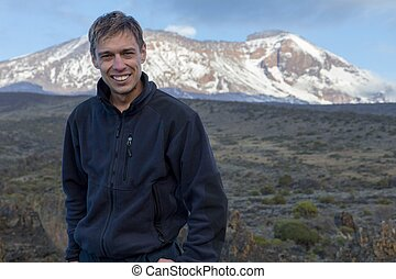 Portrait of a man against the background of Mount Kilimanjaro