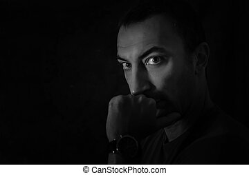 Portrait of a man, black background
