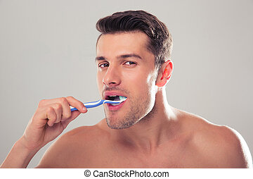 Portrait of a man brushing his teeth