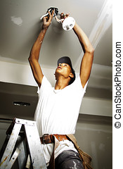 Portrait of a man doing electrical work during renovations
