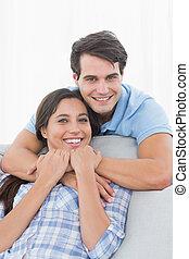 Portrait of a man embracing his par