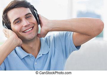 Portrait of a man enjoying music