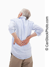 Portrait of a man having a back pain against a white...
