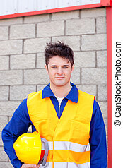 Portrait of a man holding a hardhat