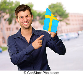 Portrait of a man holding flag