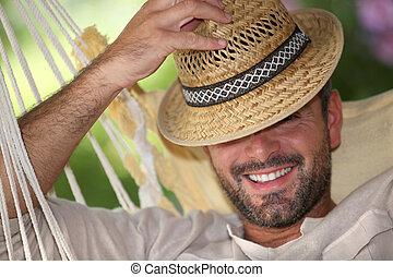 portrait of a man in a hammock