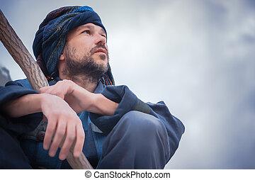Portrait of a man in blue turban