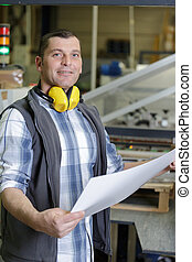 portrait of a man in factory