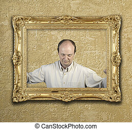 Portrait of a man in gold frame on wall
