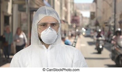 Portrait of a man in protective clothing standing downtown.