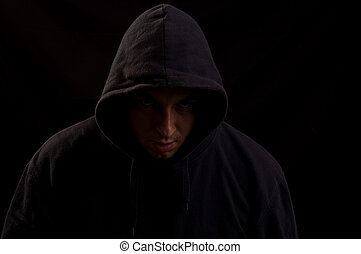 Portrait of a man in the dark looking straight at you with a scary look