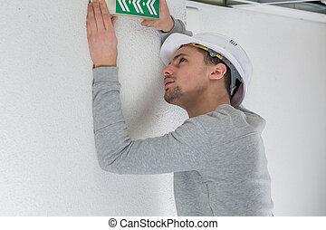 portrait of a man installing emergency signal