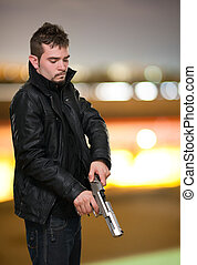 Portrait Of A Man Loading Gun