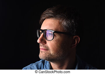 portrait of a man on black background