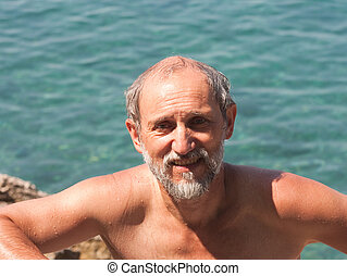 Portrait of a Man on the background of the sea