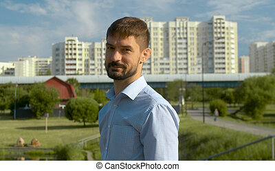 Portrait of a man on the city background