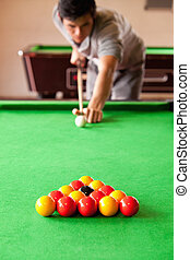 Portrait of a man playing snooker