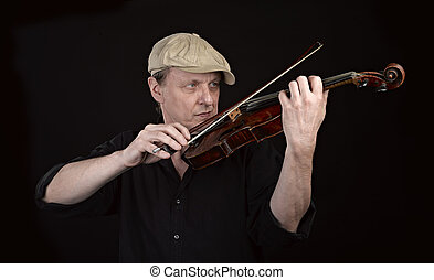 Portrait of a man playing  wooden violin