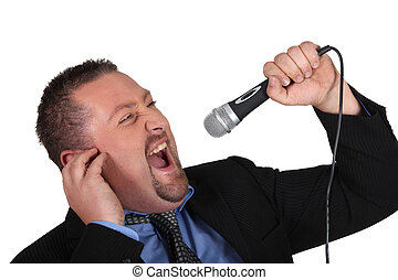 Portrait of a man screaming into a microphone