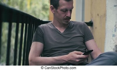 Portrait of a man scrolling in smartphone
