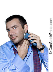 Portrait of a man shaving with electric shaver