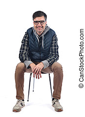 portrait of a man sitting on a chair on white