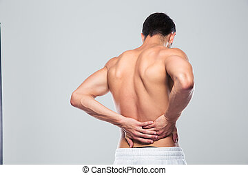 Portrait of a man standing with back pain