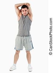 Portrait of a man stretching his arm