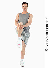 Portrait of a man stretching his leg