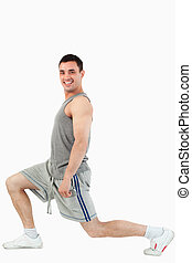 Portrait of a man stretching his legs