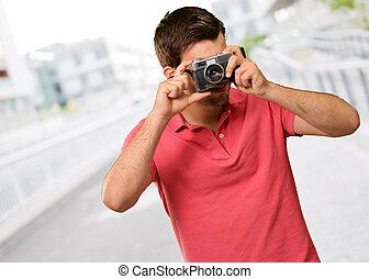 Portrait of a man taking photo
