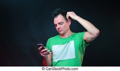 Portrait of a man typing text message on smartphone.