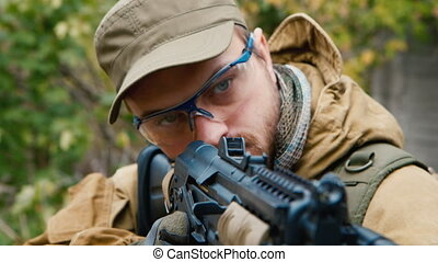 Portrait of a man with a gun. Airsoft game