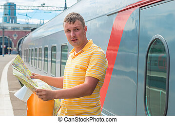 portrait of a man with a map at the station
