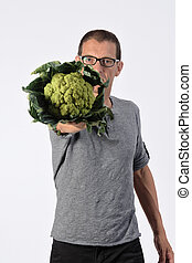 portrait of a man with broccoli on white background