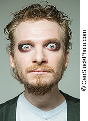 portrait of a man with bulging eyes. makeup